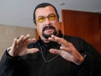 Actor Steven Seagal speaks to the media at a news conference in Moscow.