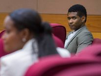 R&B singer Usher and his ex-wife Tameka Foster wait for court to begin during a custody hearing at Fulton County Courthouse in Atlanta