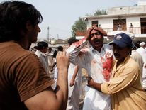 A man cries at the death of his brother at the site of the blast