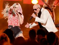 "Pitbull performs his song ""Timber"" with Ke$ha at the 41st American Music Awards in Los Angeles"