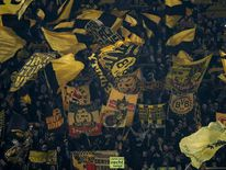 Borussia Dortmund's supporters wave flags ahead