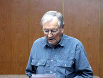 KCNA handout shows Merrill Newman reading from a piece of paper at an undisclosed location in North Korea