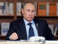 Russian President Putin attends a meeting with academics at the Moscow State University