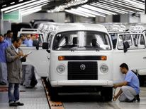 Labourers work on the assembly line of the Volkswagen Kombi at the Volkswagen plant in Sao Bernardo do Campo
