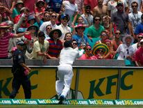 England's Carberry goes for an unsuccessful catch, a boundary hit by Australia's Harris, during the third day of the fifth Ashes cricket test at the Sydney cricket ground