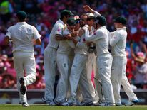 Australia's Lyon celebrates with teammates after taking the wicket of England's  Borthwick  during the third day of the fifth Ashes cricket test at the Sydney cricket ground