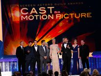 """Actor Bradley Cooper accepts the award for Outstanding Performance by a Cast in a Motion Picture for """"American Hustle"""" at the 20th annual Screen Actors Guild Awards in Los Angeles"""