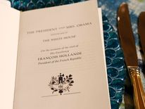 A menu for Tuesday's state dinner to honor French President Hollande is pictured during a media preview at the White House in Washington