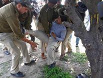 Policemen detain a supporter believed to be a pro-Telangana activist