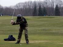 A man plays golf at the Mezhyhirya residence of Ukraine's President Yanukovych outside Kiev.