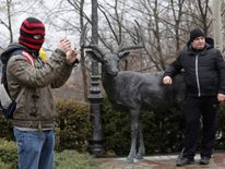 An anti-government protester takes pictures in the grounds of the Mezhyhirya residence of Ukraine's President Viktor Yanukovych.