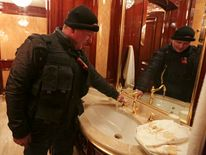 A man turns on a water tap inside the residence of Ukraine's President Viktor Yanukovych in the village Novi of Petrivtsi outside Kiev.