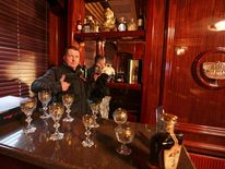 A man gestures behind the interior bar inside the residence of Ukraine's President Viktor Yanukovych in the village of Novi Petrivtsi outside Kiev.