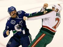 Vancouver Canucks' Hordichuk fights Minnesota Wilds' Boogaard