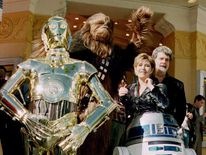 C-3PO, Chewbacca, Carrie Fisher and George Lucas