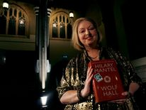 "Author Hilary Mantel poses with her book ""Wolf Hall"" after winning the 2009 Man Booker Prize for Fiction at the Guildhall in London"