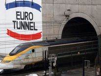 A high-speed Eurostar train leaves the Eurotunnel in France