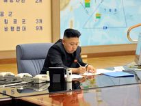 North Korean leader Kim Jong-Un at an emergency meeting with military chiefs - with an Apple iMac on his desk.