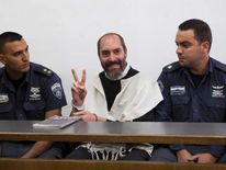 "Yaakov ""Jack"" Tytell gestures before the start of a sentencing hearing at the Jerusalem District Court"