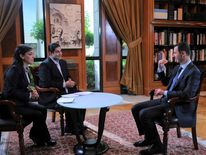 Syria's President Bashar al-Assad attends an interview with Syrian television channel al-Ikhbariya in Damascus