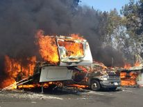 Recreational vehicles burn at the Springs Fire in the Camarillo Springs area of Ventura County, California