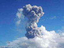 Ash rises after a mild eruption of Mayon Volcano in Legazpi city in central Philippines