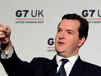 Britain's Chancellor of the Exchequer George Osborne speaks to reporters at thye close of the G7 Finance Ministers and central bank governors summit at Hartwell House in Aylesbury