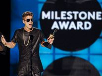 Musician Justin Bieber accepts the 'Milestone Award' during the Billboard Music Awards in Las Vegas