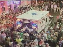 An ambulance arrives following a shooting during Mardis Gras celebrations in New Orleans.