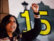 Seattle City Council member-elect Sawant addresses the crowd during a rally to raise the hourly minimum wage for fast-food workers in Seattle