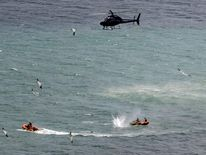 Police shoot at a shark from a helicopter