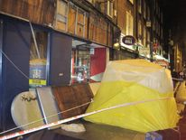 Police sealed off the area around a William Hill shop after a man was killed by a falling sign.