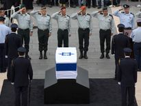 Israeli Generals salute in front of the coffin of former prime minister Ariel Sharon