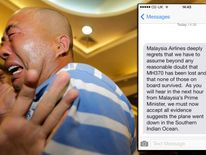 Relatives of passengers aboard Malaysia Airlines MH370 cry after watching a television broadcast of a news conference, in the Lido hotel in Beijing
