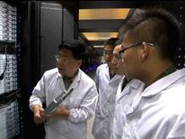 Scientists examine China's new supercomputer Tianhe-2