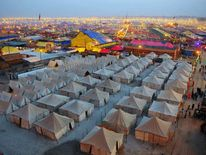 Temporary tents for devotees are pictured at dusk at Sangam, the confluence of the Rivers Ganges, Yamuna and mythical Saraswati, during the Maha Kumbh Mela