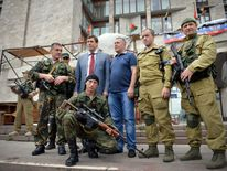 Oleg Tsarev (2ndL) outside the HQ of the Donetsk People's Republic