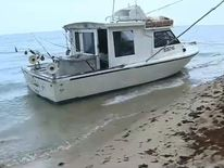 The couple's boat washed-up on shore at Fort Lauderdale. Pic: WSVN