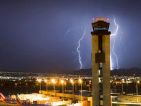 Lightning strikes south of McCarran International Airport as a thunderstorm makes its way through Las Vegas, Nevada