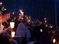 People attend a vigil for Maren Sanchez