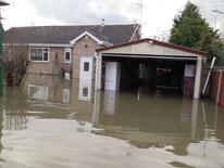 Gillie Bolton's home on Ham Island amid floods