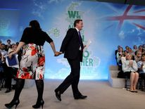 David Cameron with Sayeeda Warsi at the 2010 Tory manifesto launch