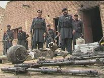 Weapons and items retrieved by police officers following an attack on a police station in Peshawar, Pakistan.