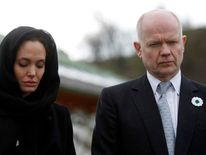 William Hague and Angelina Jolie stand in front of Srebrenica Genocide Memorial in Potocari