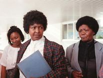 Winnie Mandela (c), then-wife of jailed-