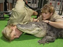 Steve Irwin and his wife Terri pose with an alligator named Bubba during the p..