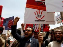 People chant slogans against U.S. drone strikes outside the Yemeni House of Representatives in Sanaa