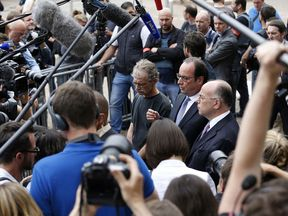 French President Francois Hollande speaks near the scene of a terrorist attack on a church