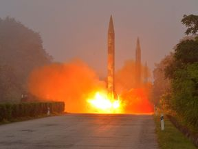 A ballistic rocket is seen launching during a drill by the Hwasong artillery units of the KPA Strategic Force.