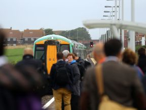 A train bound for London arrives at Seaford station on  the first  day of the new timetable